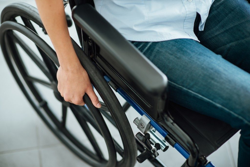 Disabled woman on a wheelchair