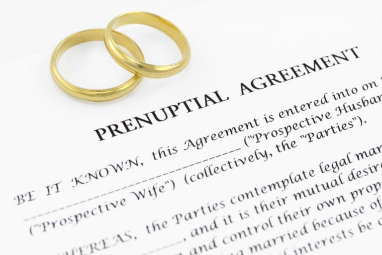 Prenuptial agreement contract with a pair of rings