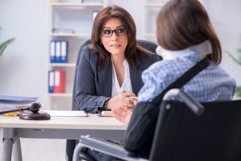 Personal Injury Lawyer with an injured woman