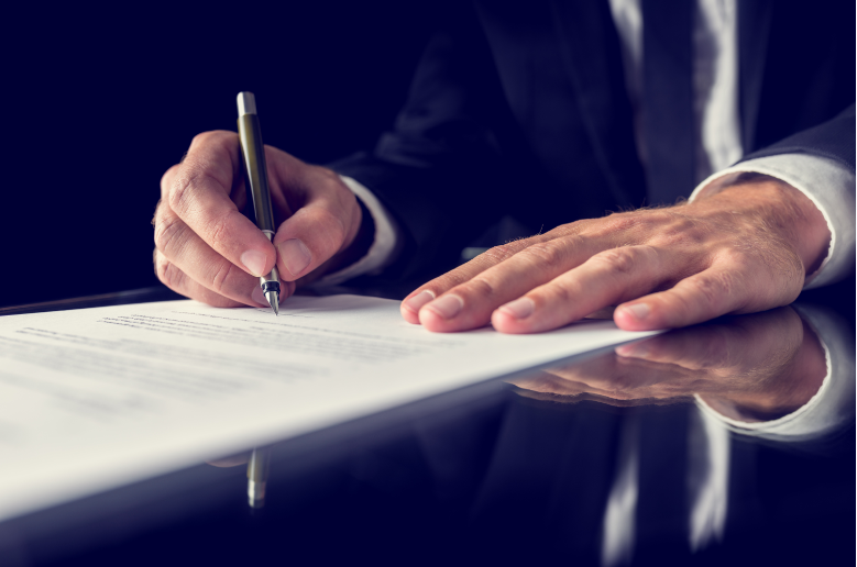 Lawyer signing a legal document
