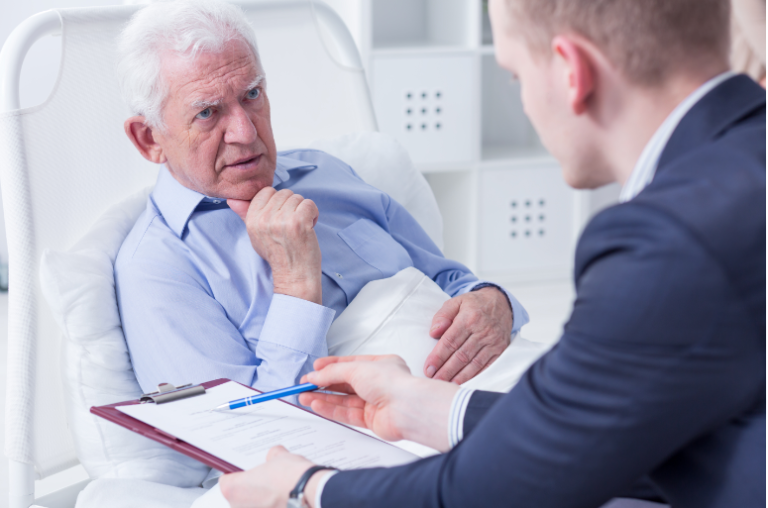 Senior talking to a lawyer for his will