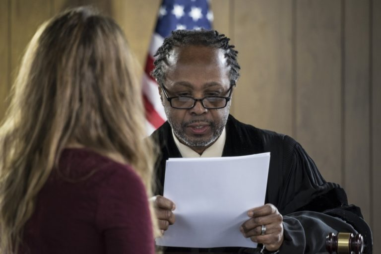 girl and judge inside a courtroom