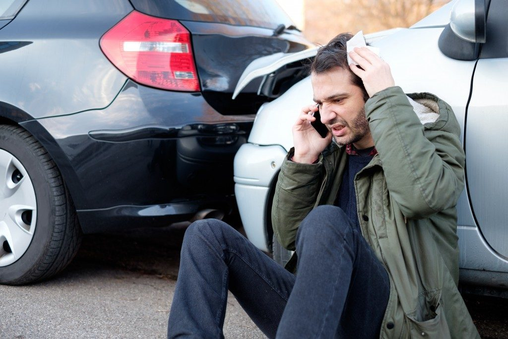 Man calling in a car crash