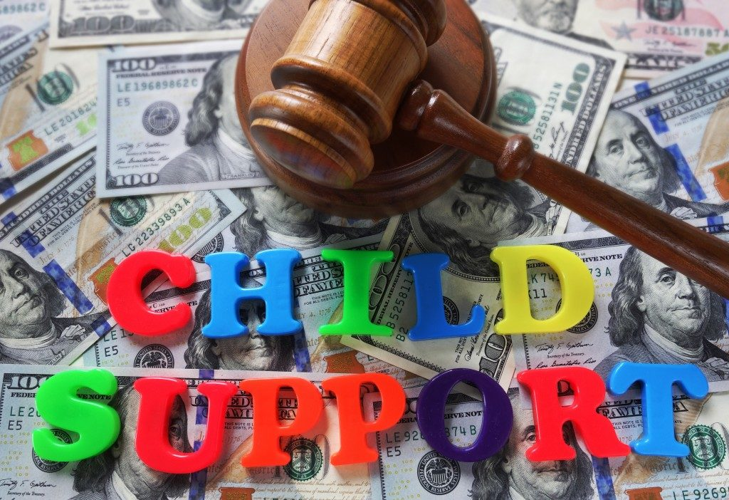 Child Support Word Over Dollar Bills and Gavel