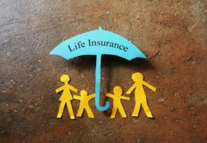 family cutout under a life insurance umbrella