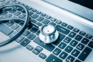 stethoscope with laptop